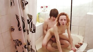 Small tits redhead chick spreads her legs to ride a dick in the bathroom