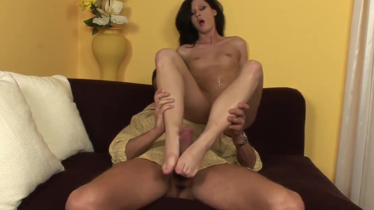 Young leggy brunette with slim legs and sexy feet gives foot